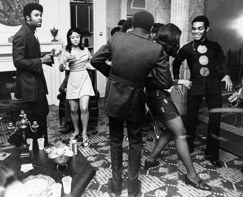 Temptation Dennis Edwards, far left, and cast members party at the Gordy Mansion, April 13, 1970. (Motown Record Corp.)