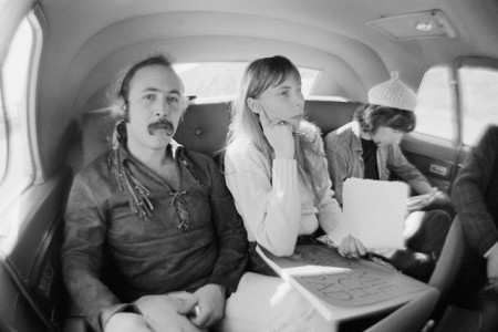 February 1969, California, USA --- Musicians David Crosby (left), Joni Mitchell and Graham Nash travel to Big Bear Lake. --- Image by © Henry Diltz/CORBIS